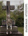 Skeleton Sitting On A Large...