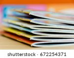 edge book on the wooden table.  ... | Shutterstock . vector #672254371