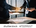young businessmen collaborate... | Shutterstock . vector #672255217