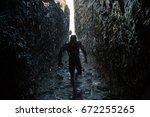 adventure seeking cave... | Shutterstock . vector #672255265