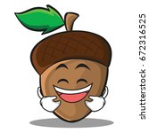 laughing acorn cartoon...   Shutterstock .eps vector #672316525