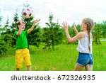 Happy Children Play With A Bal...