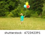 a little child with balloons | Shutterstock . vector #672342391