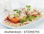 italian parmesan chicken with...   Shutterstock . vector #672346741