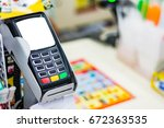 payment terminal in convenience ... | Shutterstock . vector #672363535