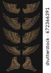 set of golden wings on dark... | Shutterstock .eps vector #672366391