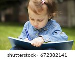 little baby girl learns to... | Shutterstock . vector #672382141