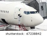 snow removal from airplane | Shutterstock . vector #67238842