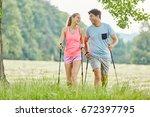 couple having fun while nordic... | Shutterstock . vector #672397795