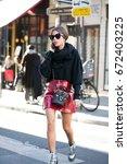 paris october 5  2016. street... | Shutterstock . vector #672403225