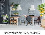 big communal table in loft... | Shutterstock . vector #672403489