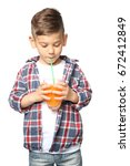 cute little boy drinking juice... | Shutterstock . vector #672412849