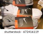 socks nike in store. ukraine ... | Shutterstock . vector #672416119