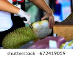 durian peeling | Shutterstock . vector #672419059