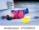 worker in a faint after on the... | Shutterstock . vector #672420019