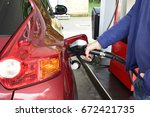 a man pumping or putting... | Shutterstock . vector #672421735