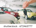 passing car keys. cropped... | Shutterstock . vector #672463777