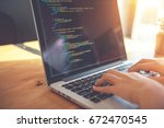 closeup coding on screen  woman ... | Shutterstock . vector #672470545