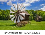 traditional rustic houses in... | Shutterstock . vector #672483211