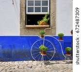 charming medieval street of the ... | Shutterstock . vector #672487309