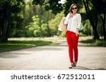 woman shopping | Shutterstock . vector #672512011