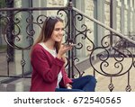 portrait of a girl using the...   Shutterstock . vector #672540565