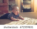 a cute little baby is crawling... | Shutterstock . vector #672559831