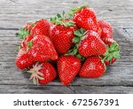 Pile Of Ripe Strawberry On Old...