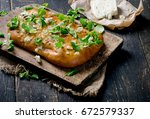 homemade italian focaccia bread.... | Shutterstock . vector #672579337