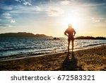 woman relaxing at the beach... | Shutterstock . vector #672583321