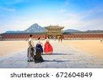 tourists visiting gyeongbokgung ... | Shutterstock . vector #672604849