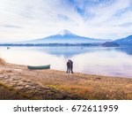 Stock photo green boat on ground at side of lake kawaguchi with asia couple traveler s to s girl stand by 672611959
