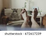 man sitting on couch after long ...   Shutterstock . vector #672617239
