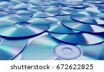 stack of cd and dvd background. | Shutterstock . vector #672622825