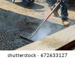 workers on asphalting paver...   Shutterstock . vector #672633127