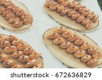 ekler on plates  small dessert  | Shutterstock . vector #672636829
