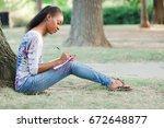 african american woman sitting...   Shutterstock . vector #672648877