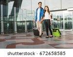 asian couple traveler with... | Shutterstock . vector #672658585