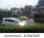 water drop on glass background | Shutterstock . vector #672667045