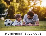 handsome dad with his little... | Shutterstock . vector #672677371