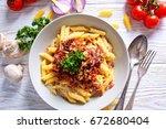 delicious spaghetti served in... | Shutterstock . vector #672680404