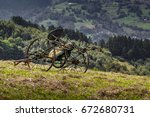 Small photo of Old retired hay tedder. Beskids Mountains, Poland.