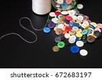 colorful buttons and thread on... | Shutterstock . vector #672683197