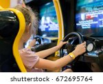 little girl playing racing... | Shutterstock . vector #672695764
