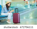 airline passenger in an airport ... | Shutterstock . vector #672706111