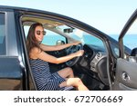 a woman sitting inside a rented ... | Shutterstock . vector #672706669