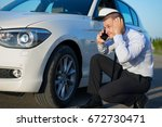 man with the white car | Shutterstock . vector #672730471
