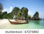 Traditional longtail boats in the famous Maya bay of Phi-phi Leh island, Krabi province, Thailand - stock photo