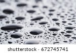 drops on a dark glass background | Shutterstock . vector #672745741