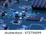 close up of electronic... | Shutterstock . vector #672754099